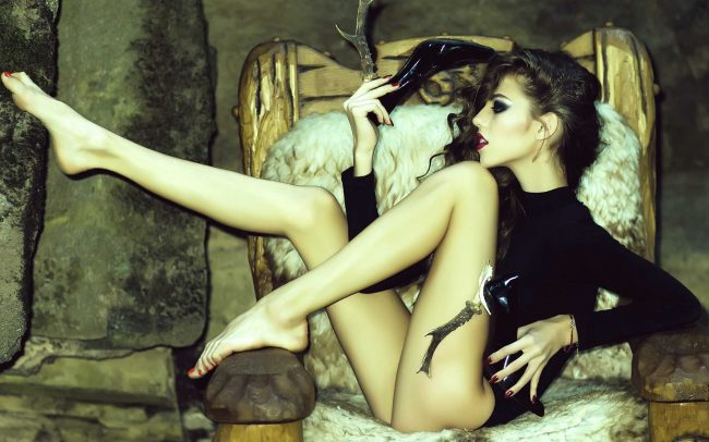attractive-woman-poses-in-rustic-chair